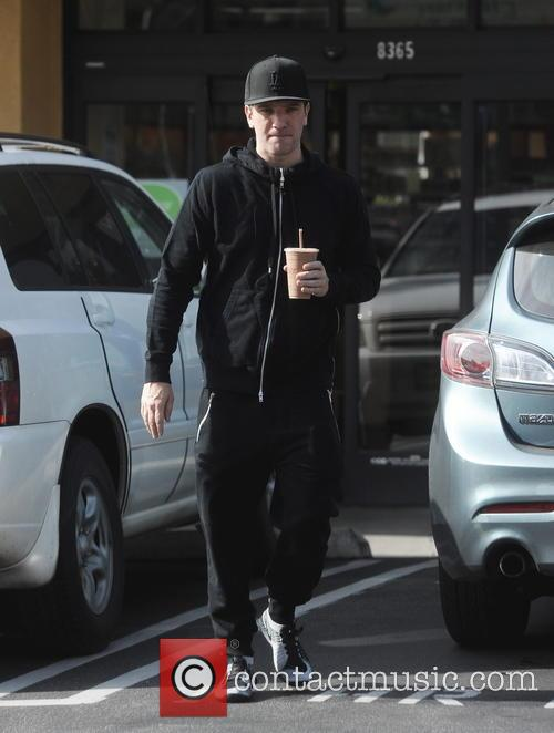 JC Chasez picks up a health drink at...
