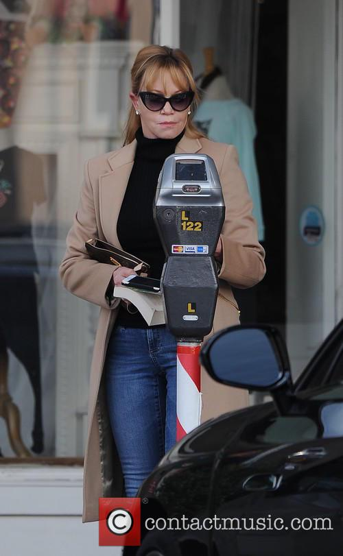 Melanie Griffith enjoys a cigarette while out shopping...