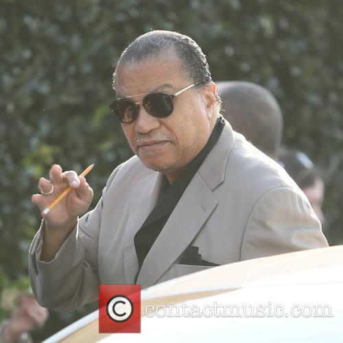Billy Dee Williams raises a pencil in solidarity...