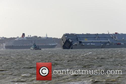 The 'Queen Elizabeth' cruise ship passes by the...