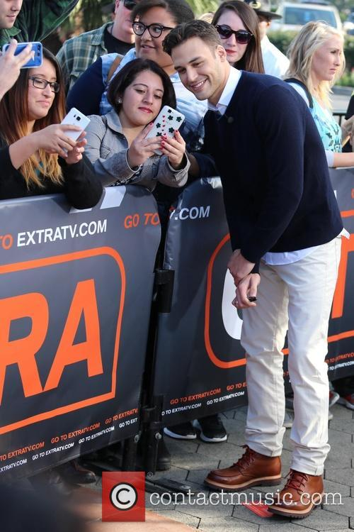 Ryan Guzman appears on Extra