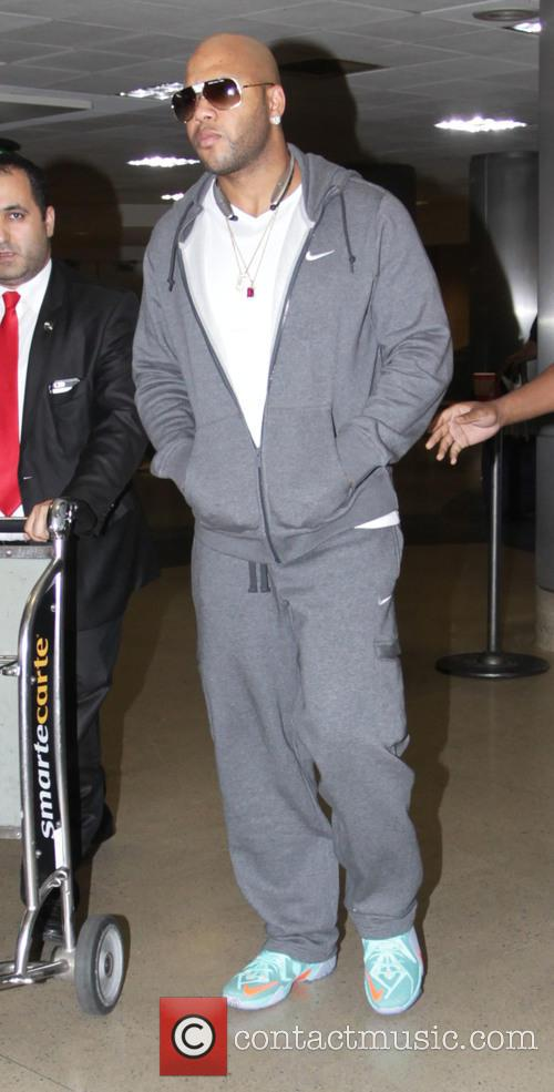 Flo Rida arrives at Los Angeles International Airport