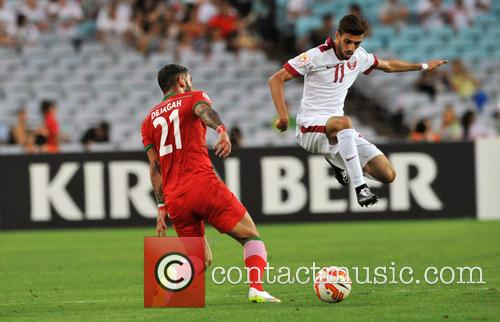 Ashkan Dejagah and Hasan Al Haydos 3