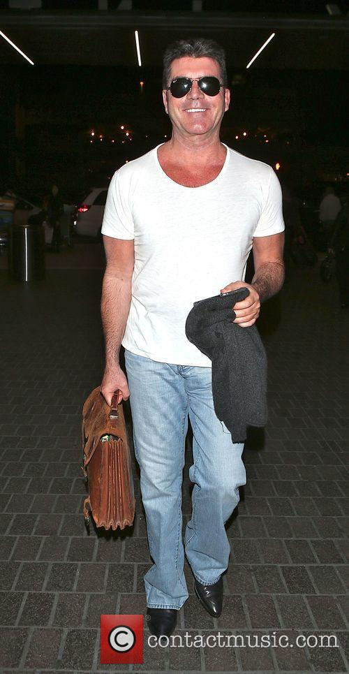 Simon Cowell departs from LAX airport