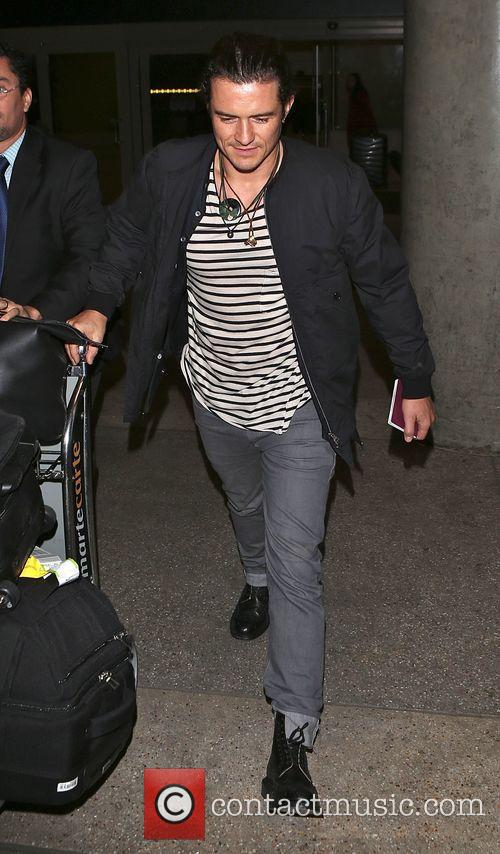 Orlando Bloom arrives at Los Angeles International Airport...