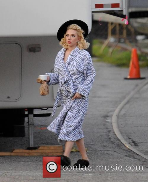 Blonde bombshell Scarlett Johansson wears a bathrobe the...