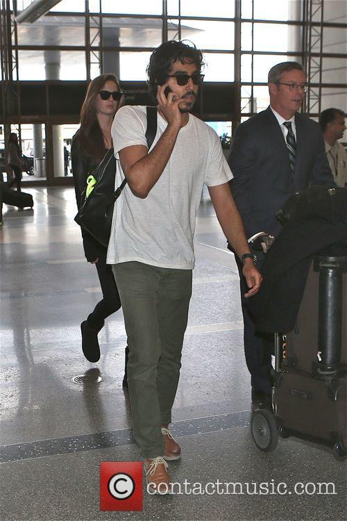 Dev Patel arrives to catch a flight at...