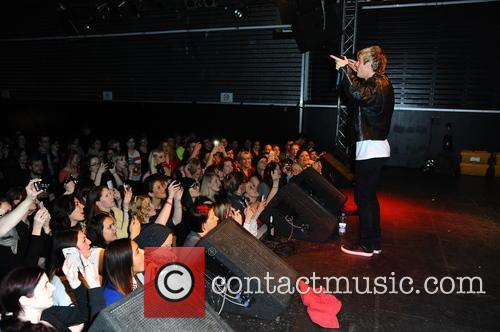 US singer Aaron Carter performing live during a...
