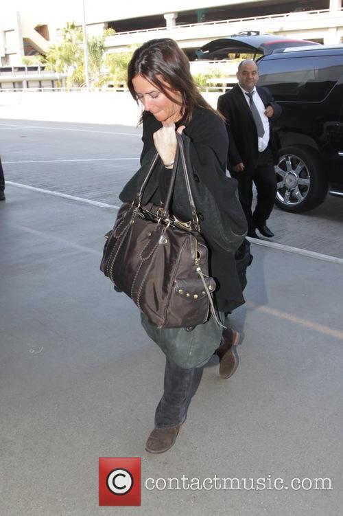 Pamela Adlon arriving at Los Angeles International Airport