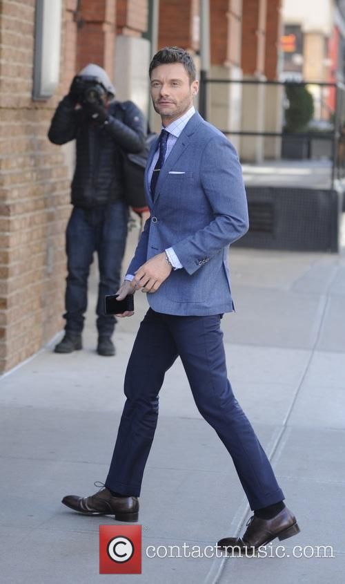 Ryan Seacrest entering his hotel in New York