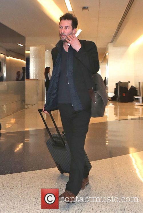 Keanu Reeves departs from Los Angeles International Airport...