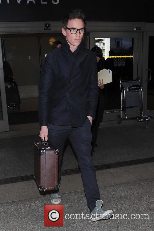 Eddie Redmayne arrives at Los Angeles International (LAX)...