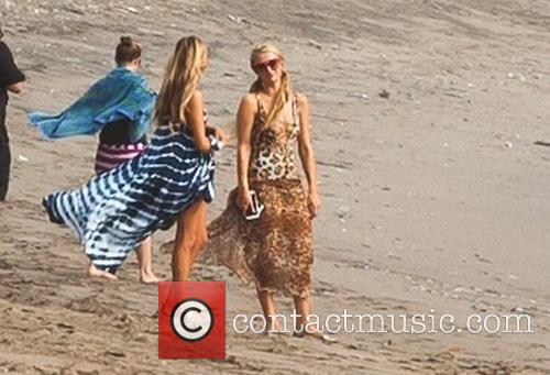 Paris Hilton spends the day on a beach...