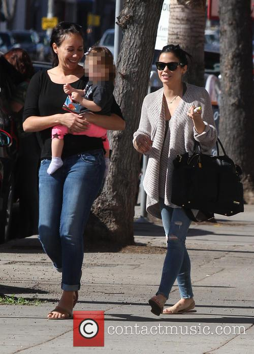 Jenna Dewan dresses down in ripped jeans and...