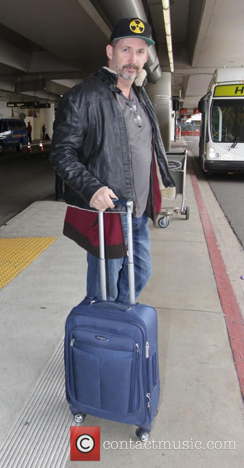 Harland Williams arrives at C International Airport