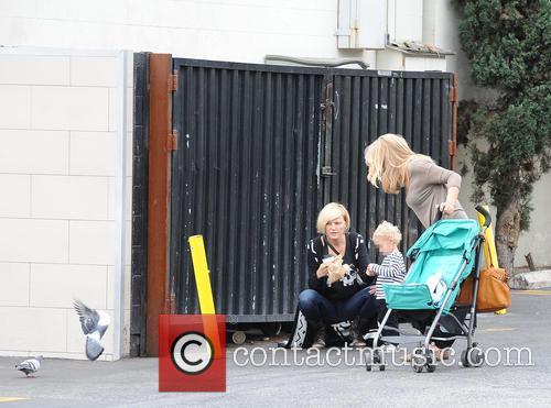 Malin Akerman and son Sebastian seen feeding...