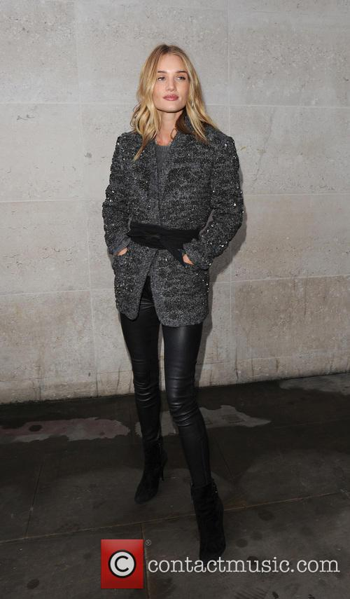 Rosie Huntington-Whiteley leaving the Radio 1 studios, and...