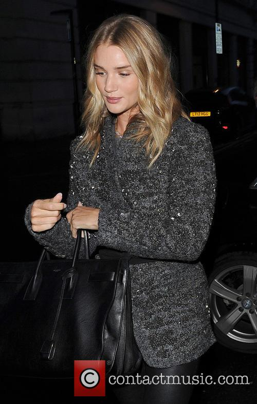Rosie Huntington-Whiteley is grabbed by an over zealous...