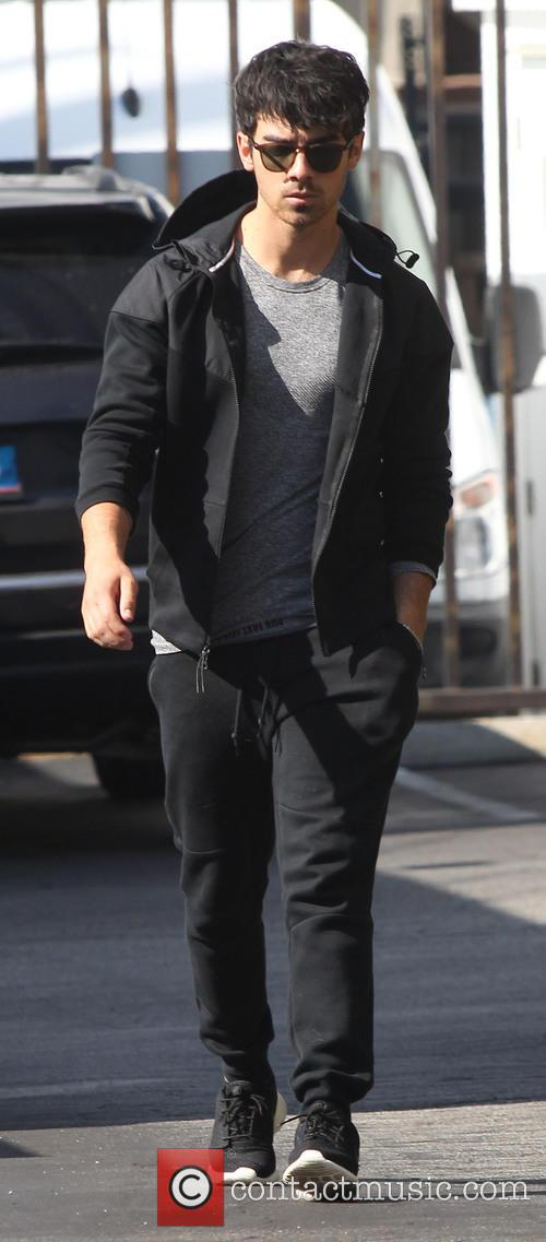 Joe Jonas out and about wearing a black...