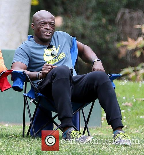 Heidi Klum and Seal watch their kids play...