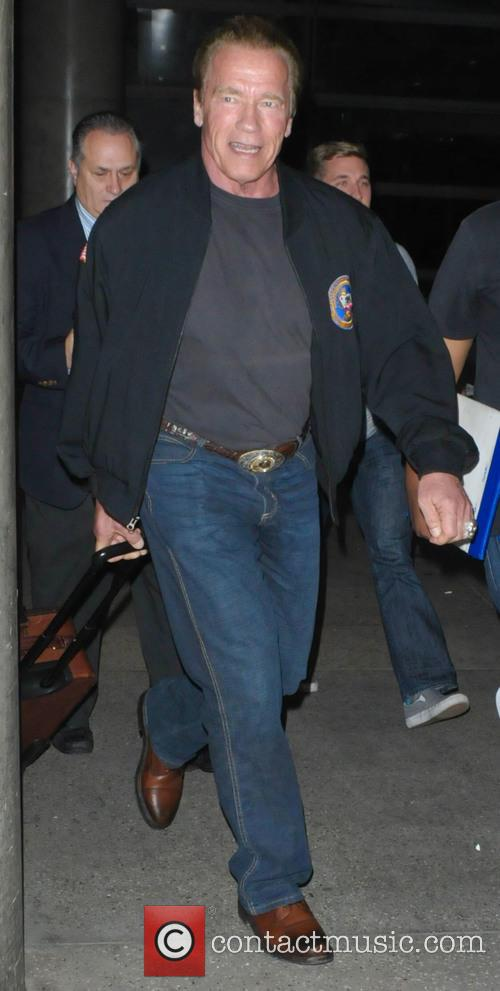 Arnold Schwarzenegger arrives back at Los Angeles International...