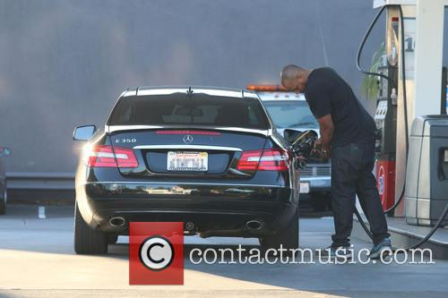 Scrubs actor Donald Faison pumping gas in West...