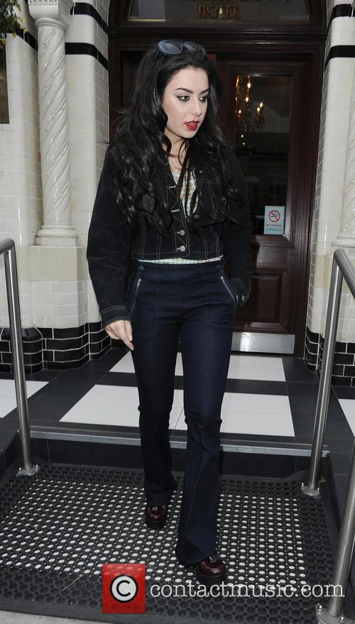 Charli XCX leaving her hotel, in a change...