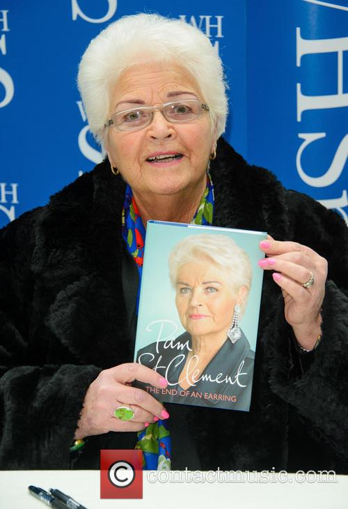 Pam St Clement signs copies of her autobiography...