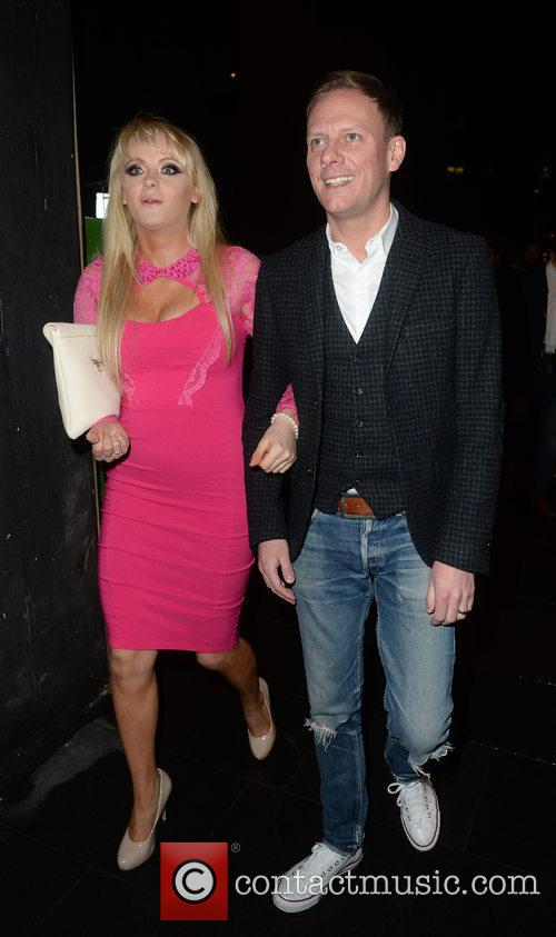 Katie McGlynn and Antony Cotton arrive arm-in-arm at...