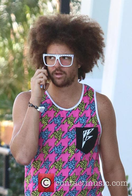 Redfoo of LMFAO sports a vibrant pink outfit...