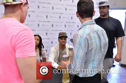Trey Songz signs bottles of SX Liquors at...