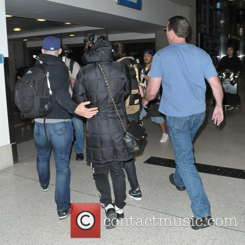 A camera-shy Katy Perry arrives at Los Angeles...