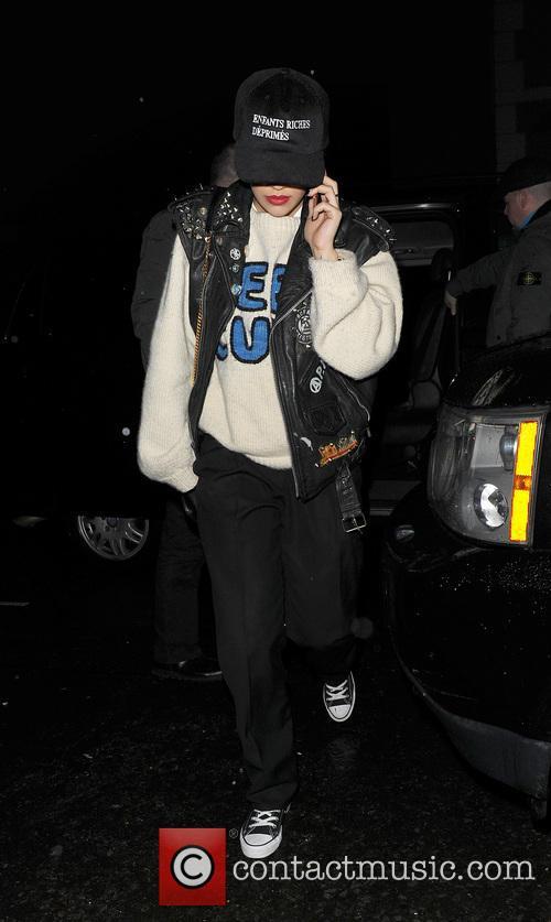 Rita Ora comes over all camera-shy as she...