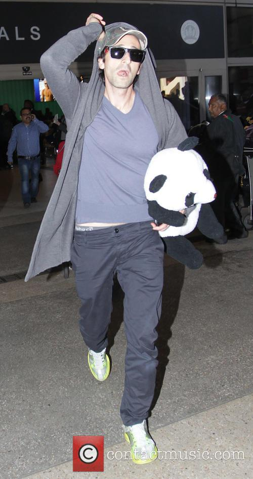 Adrien Brody arrives at Los Angeles International Airport