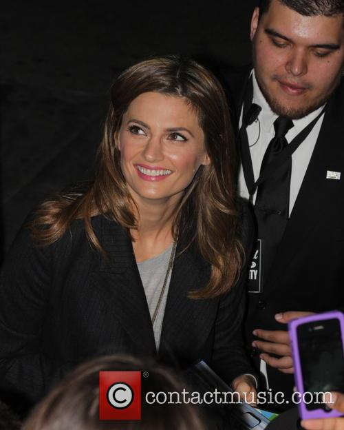Stana Katic greets fans as she departs Jimmy...