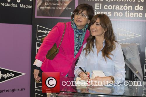 Spanish television star Mariló Montero signs copies of...