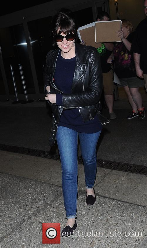 Felicity Jones arrives at Los Angeles International (LAX)...