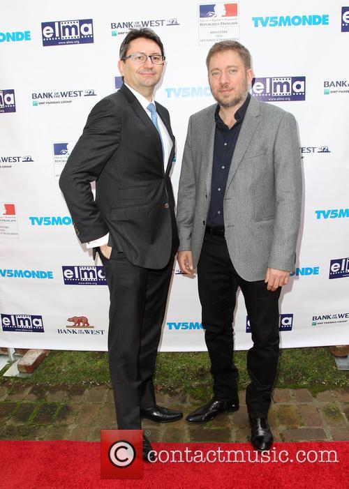 Mr. Axel Cruau and Ivi Robert 3