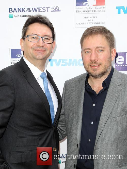 Mr. Axel Cruau and Ivi Robert 4