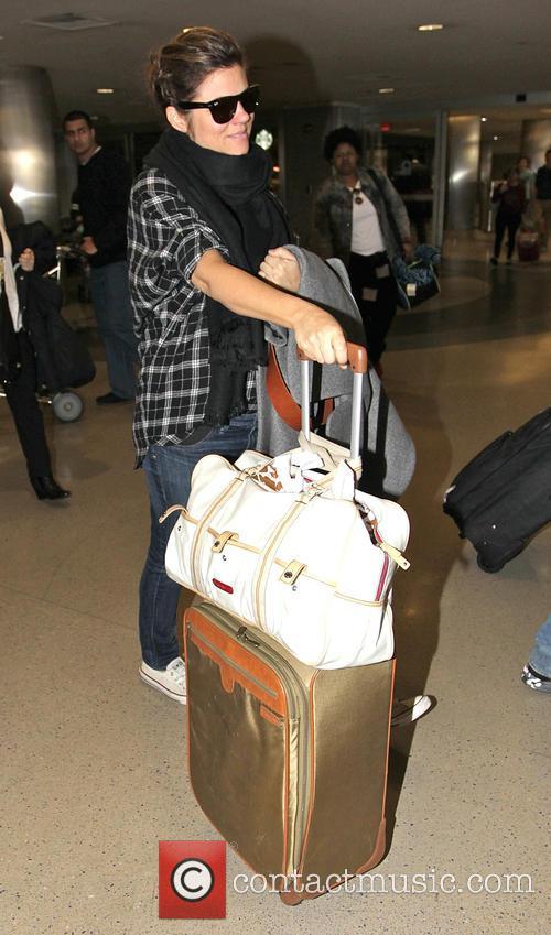 Tiffani Thiessen arrives at Los Angeles International Airport