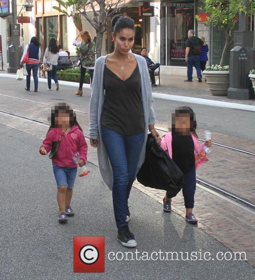 V. Stiviano takes her family shopping at The...