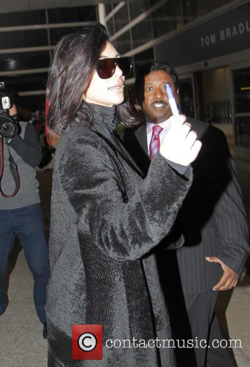 Kim Kardashian West arrives at Los Angeles International...