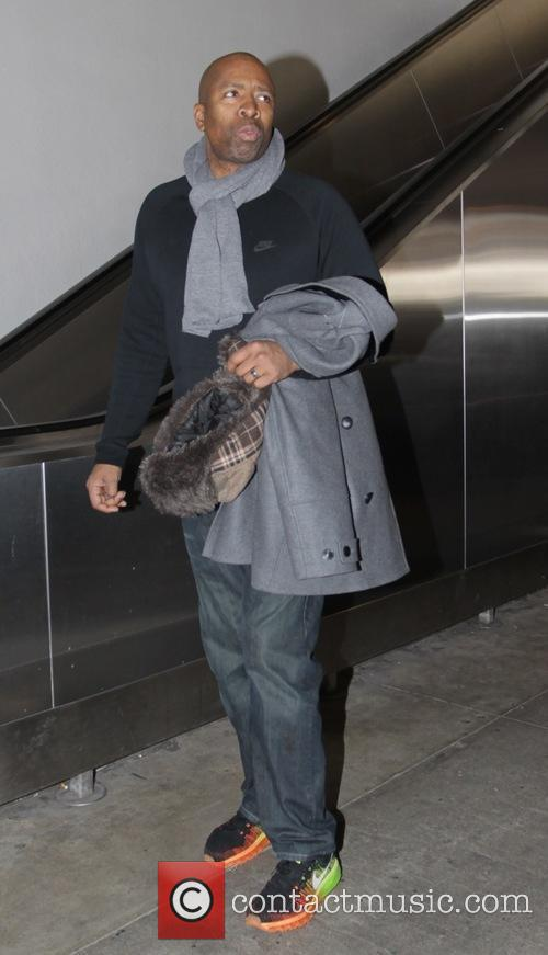 Kenny Smith arrives at Los Angeles International Airport...