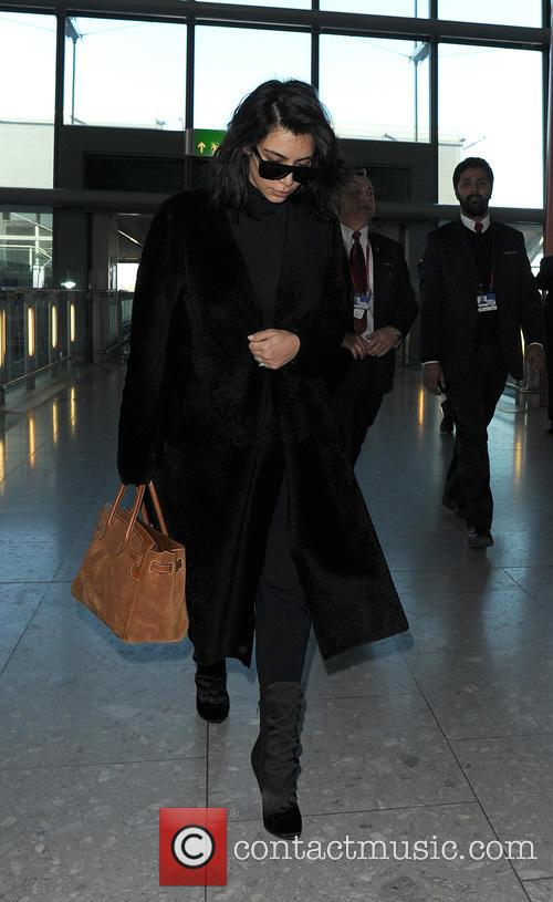 Kim Kardashian arrives at Heathrow Airport alone, to...