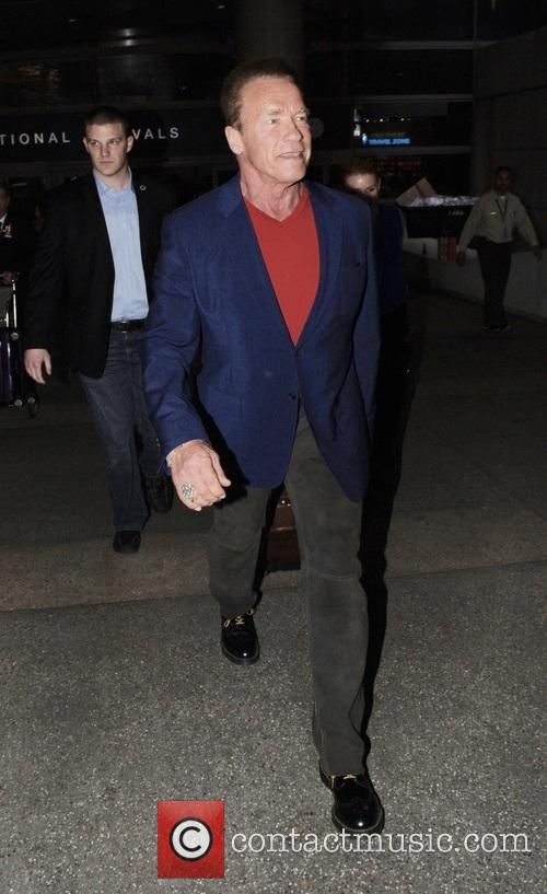 Arnold Schwarzenegger arrives at Los Angeles International Airport...