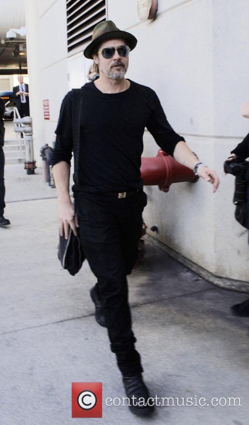 Brad Pitt arrives at Los Angeles International Airport...
