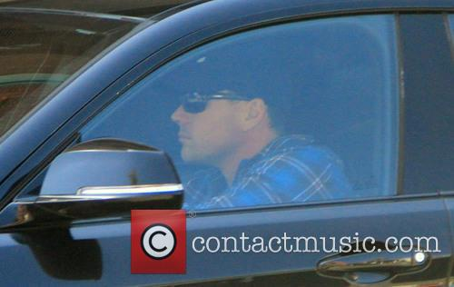 Chris Klein in his BMW car in Beverly...