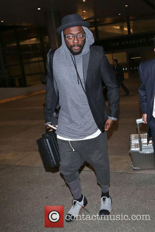 will.i.am arriving at LAX airport in Los Angeles