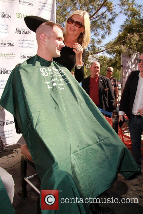 Olivia Newton-John shaves heads for charity at the...