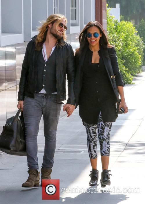 Zoe Saldana and her husband Marco go to...